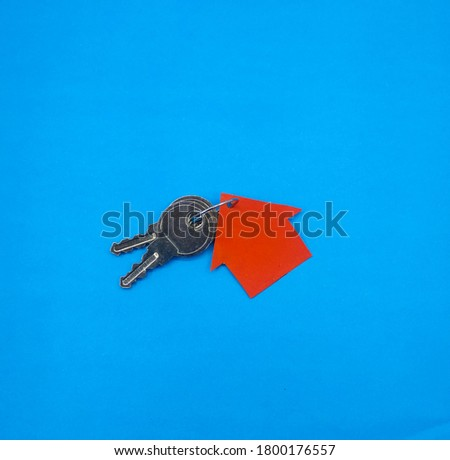 House Key with blue Background Stock Photos, Pictures & Royalty Free Images