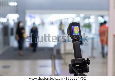 Thermal scanner to check the temperatures of passengers arriving airport. Automatic measuring temperature woman at hospital .Covid-19 test temperature for human. #1800224752