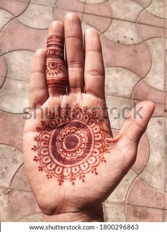 Indian Men Showing Henna Desing. Mehndi Tattoo on Hand