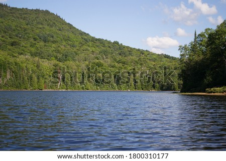 East canadian landscape. Reflection of a mountain in a lake. Coniferous trees landscape #1800310177