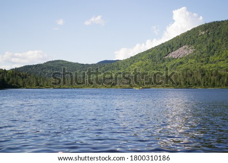 East canadian landscape. Reflection of a mountain in a lake. Coniferous trees landscape #1800310186