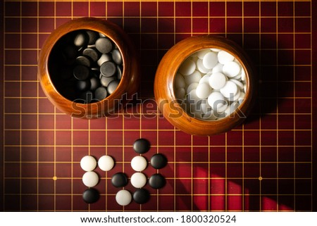 GO is an abstract strategy board game for two players - Other names for Go are: Igo (alternate Japanese name), Weiqi or Weichi ( Chinese names), and Baduk (Korean name) #1800320524