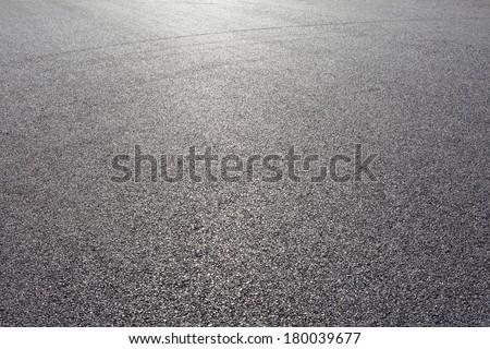close-up horizontal view of new asphalt road Royalty-Free Stock Photo #180039677