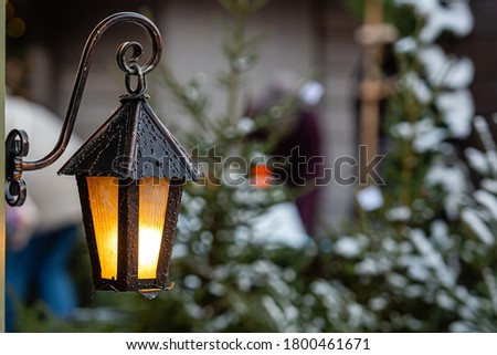 Medieval lanterns with spruce branches at Christmas market. Riga, Latvia - image