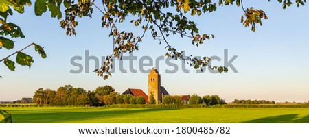 Typical Dutch protestant church called Bartholomeuskerk during sunset in Westhem in Friesland, Netherlands, Europe