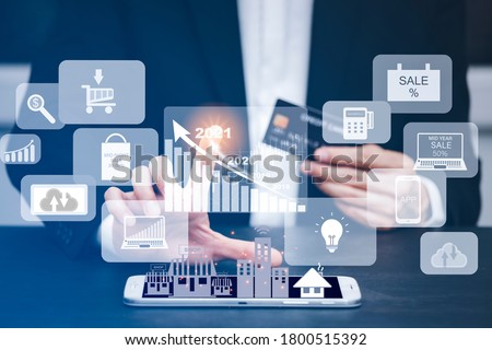The businessman is Select the graph icon and uses a modern credit card by laptop or smartphone.shopping online on the card and buy order shopping online.