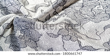 texture, background, pattern. Silk white fabric with lace patterns. This elastic lace trim can add a delicate touch to everything! Decorate your jewelry with your projects, crafts and Internet decor #1800661747