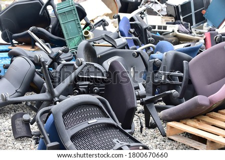 Piles of discarded chairs and furniture rubbish Royalty-Free Stock Photo #1800670660