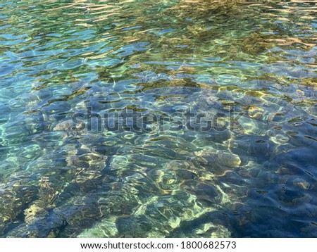 Beautiful crystal clear sea water. Ripple in the water. Want to dive. Aquatic paradise. Crystal clear Mediterranean sea. Ocean smooth surface. Amazing turquoise Adriatic sea. Blue marine. Light waves.