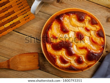 Picture of baked in oven hot tasty apple pie served at plate