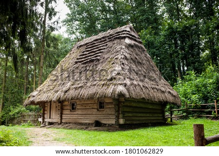 Old authentic wooden house with a thatched roof Royalty-Free Stock Photo #1801062829