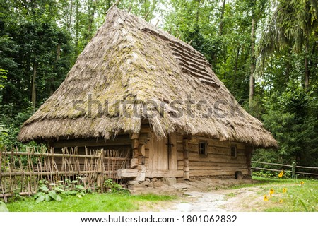 Old authentic wooden house with a thatched roof Royalty-Free Stock Photo #1801062832