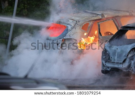 Swedish fire brigade that extinguishes a major car fire where 18 cars were set on fire during the night. Pictures taken May 27
