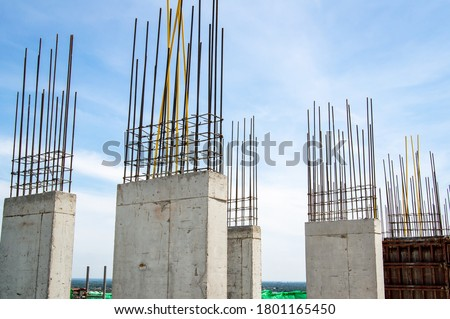 Steel reinforce in concrete column.Steel grid on the construction site.Reinforcement of concrete work. Using steel wire for securing steel bars with wire rod for reinforcement of concrete  #1801165450