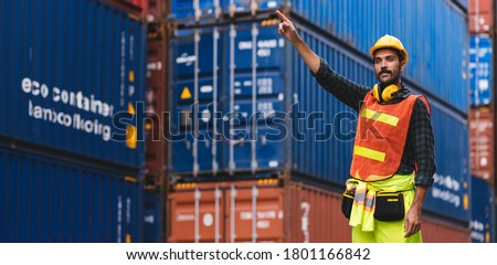 Panoramic smart creative foreman engineer man control loading containers box from cargo freight ship for import export. Logistic, transportation, import and export concept with copy space. Royalty-Free Stock Photo #1801166842