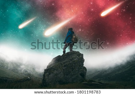 Traveler with a backpack looking at colorful nebula with falling asteroids.