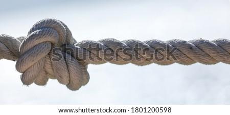 marine nautical rope on sea background Royalty-Free Stock Photo #1801200598