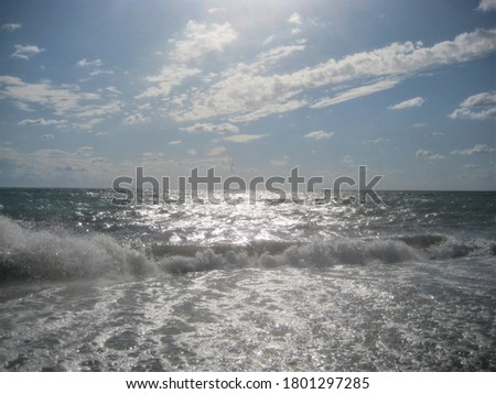 macro photo with a decorative background of sea perspective and a blue sky with white splashes of surf water foam for design as a source for prints, posters, decor, interiors