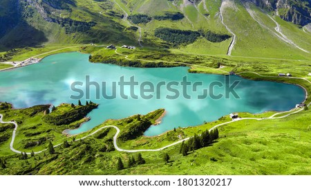 The beautiful mountain lake in the Swiss Alps - aerial view on Mount Titlis - travel photography