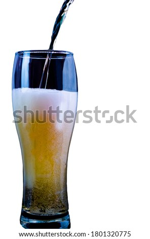 Pouring light beer into a beer glass,isolated on white,close-up,vertical picture