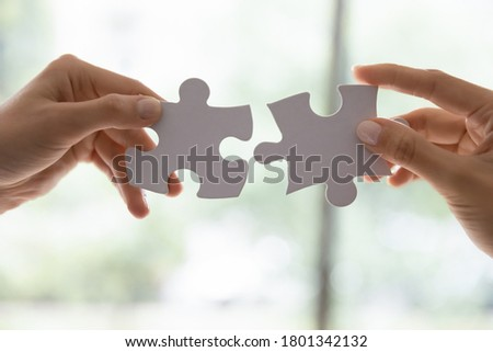 We give you exactly what you need. Male businessman making best offer to female customer, man and woman in love feeling perfect for each other, two diverse teammates doing work together, close up Royalty-Free Stock Photo #1801342132