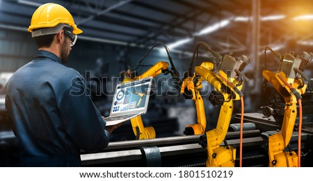Smart industry robot arms for digital factory production technology showing automation manufacturing process of the Industry 4.0 or 4th industrial revolution and IOT software to control operation . #1801510219