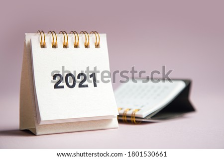 Happy new year 2021. Close up calendar on a pink desktop