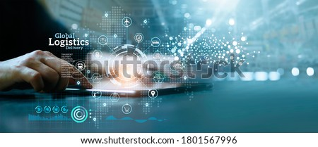 Businessman analyzing business growth global logistics network distribution and transportation successful on industrial container large warehouse center background.  Royalty-Free Stock Photo #1801567996