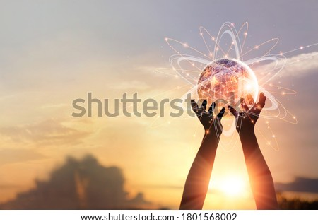 Man hands holding global network and data customer connection, Abstract science, on nature background. Elements of this image furnished by NASA Royalty-Free Stock Photo #1801568002