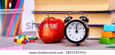 Banner of Back to school supplies. Still life with alarm clock.