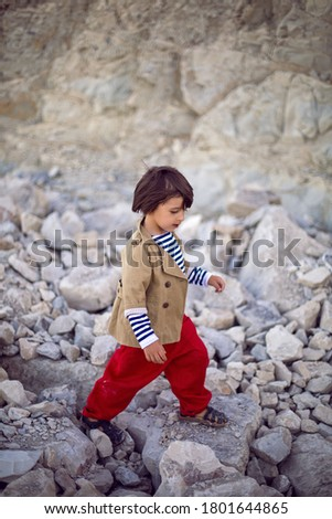 stylish boy sailor in a vest and red pants walk on the seashore in summer #1801644865