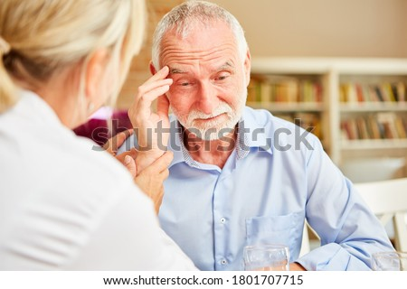 Senior with dementia or Alzheimer's is comforted by caring female doctor #1801707715