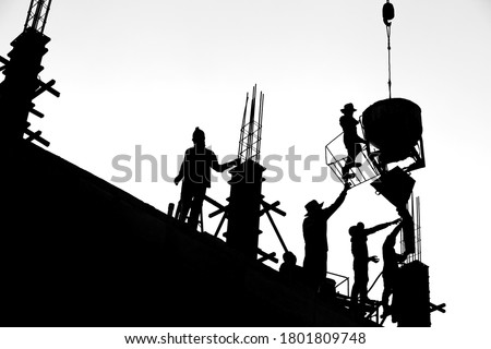 Construction workers are casting columns to build buildings using cranes. It is a black and white style picture. #1801809748