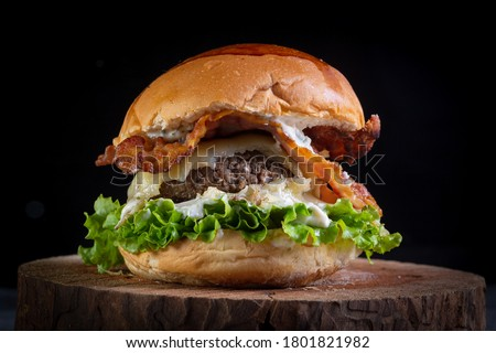 Two smash burgers with cheese, bacon, letuce and garlic sauce. Rustic craft burger. Royalty-Free Stock Photo #1801821982