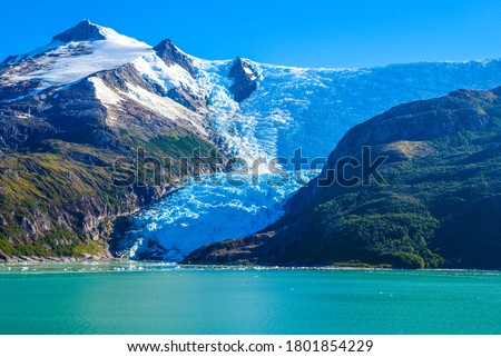 The southern coast of Chile presents a large number of fjords and fjord-like channels from the latitudes of Cape Horn Royalty-Free Stock Photo #1801854229