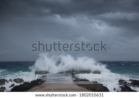 A selective focus shot of a dock in Grand Cayman as Hurricane Laura passes by #1802010631