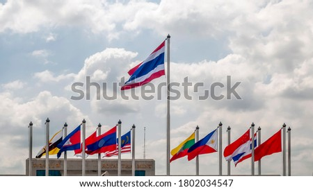 Flags of Asian states fly near the Royal Thai Mint building in Bangkok, Thailand