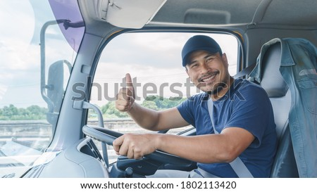 Smile Confidence Young Man Professional Truck Driver In Business Long transport Royalty-Free Stock Photo #1802113420