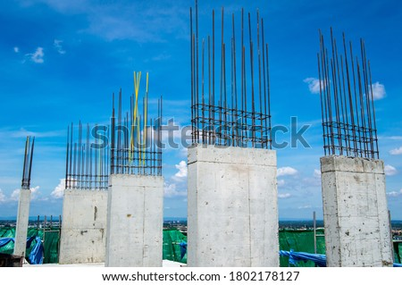 Steel reinforce in concrete column.Steel grid on the construction site.Reinforcement of concrete work. Using steel wire for securing steel bars with wire rod for reinforcement of concrete  #1802178127