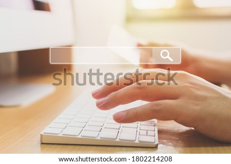 Searching information data on internet networking concept. Hand of male typing text on laptop keyboard