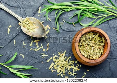 Raw and dry tarragon spice.Tarragon or Artemisia dracunculus #1802238274