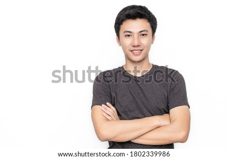 Attractive beautiful positive asian man - close up portrait of asian teenage man. Portrait of handsome nerd Japanese asia guy wearing t-shirt with big smile isolated on white background. Royalty-Free Stock Photo #1802339986