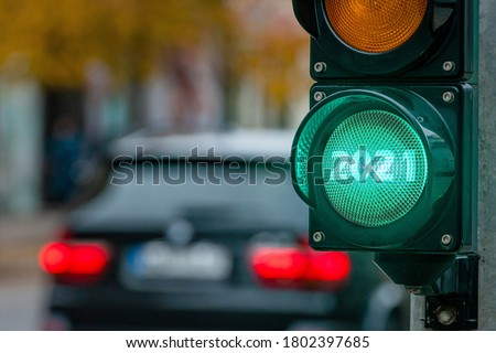 A city crossing with a semaphore. Green light with text 2021 in semaphore. New Year background concept