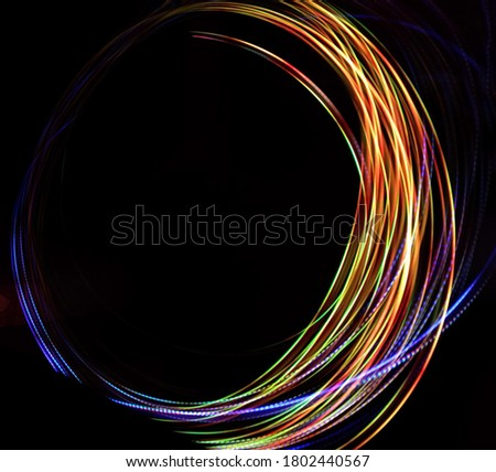 Neon blurry circles at motion . Vector swirl trail effect . Abstract luminous rings slow shutter speed effect . Light painting . Abstract lights at motion exposure time
