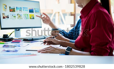 Advertising agency designer creative start-up team discussing ideas in office.  Royalty-Free Stock Photo #1802539828