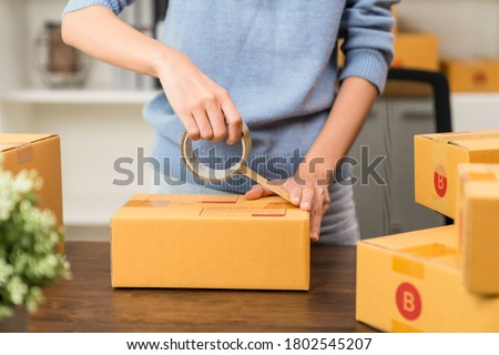 Startup small business, Young women working freelance and packing box delivery products to customers, Ordered online. Royalty-Free Stock Photo #1802545207