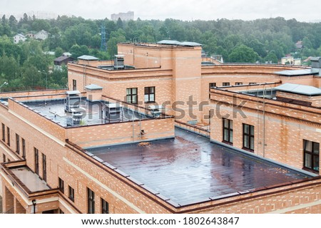 Flat roof with air conditioners top modern apartment house building mixed-use urban multi-family residential district area development. Royalty-Free Stock Photo #1802643847