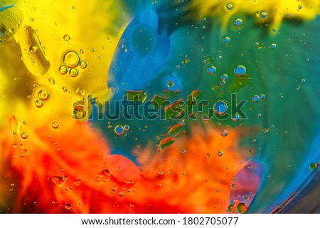Abstract colorful Background Oil in Water with colorful gradient colors. Fantastic structure of colorful oil bubbles. Chaotic motion. Psychedelic pattern image rainbow colored. Macro shot. #1802705077