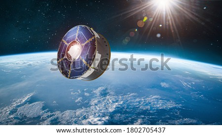 Spaceship with rover on orbit of Earth planet. Expedition to Mars. Mission Perseverance 2020. Space station. Elements of this image furnished by NASA Royalty-Free Stock Photo #1802705437