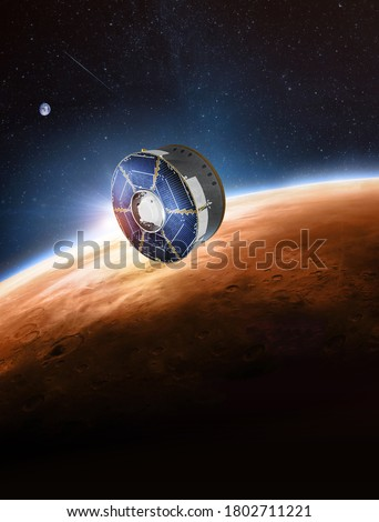 Spaceship with rover on orbit of Earth planet. Expedition to Mars. Mission Perseverance 2020. Space station. Elements of this image furnished by NASA Royalty-Free Stock Photo #1802711221